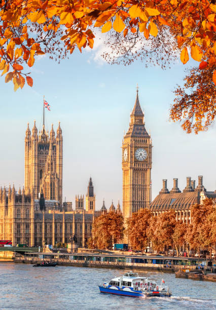 Big Ben with autumn leaves in London, England, UK stock photo