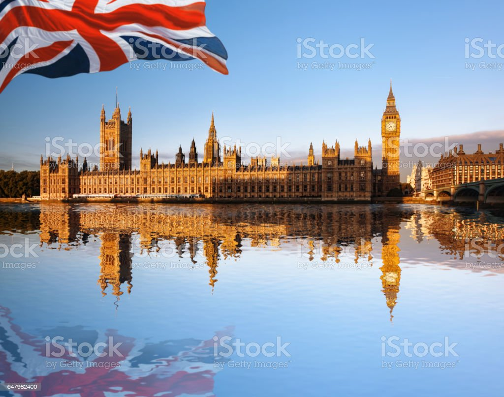 Big Ben with flag of United Kingdom in London, UK stock photo