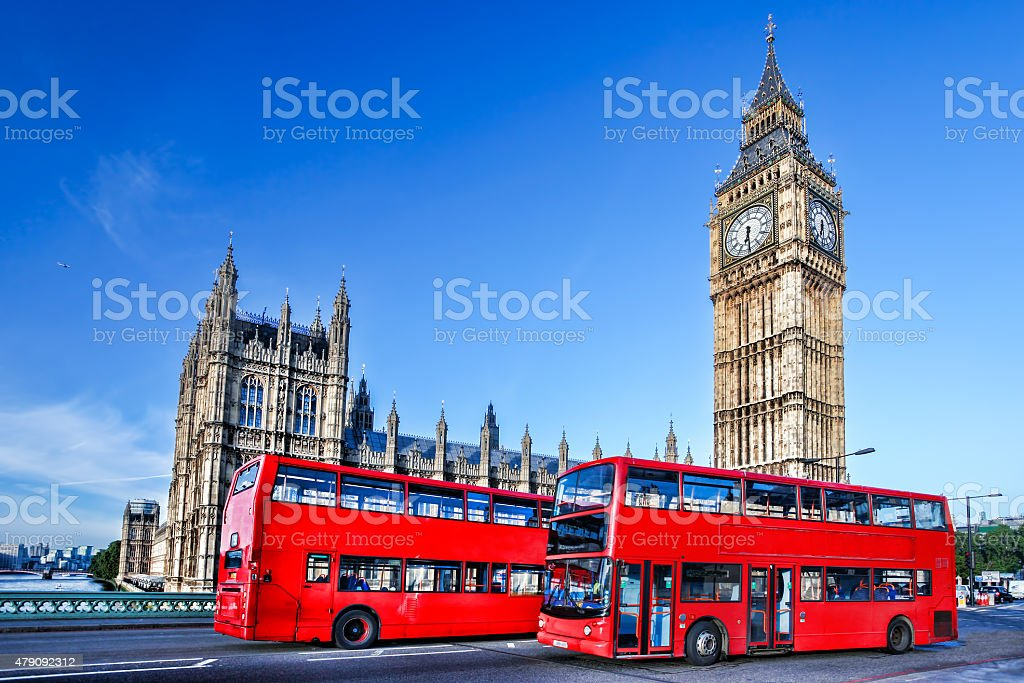 Big Ben with red buses in  London, England stock photo