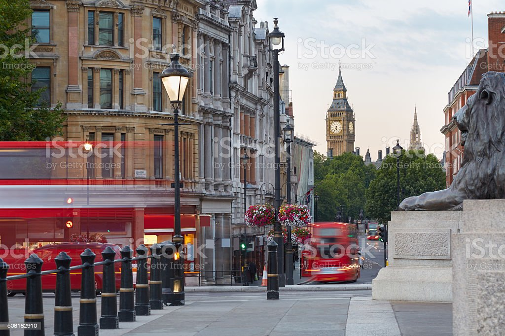 Big Ben with red London bus seen from Trafalgar square stock photo