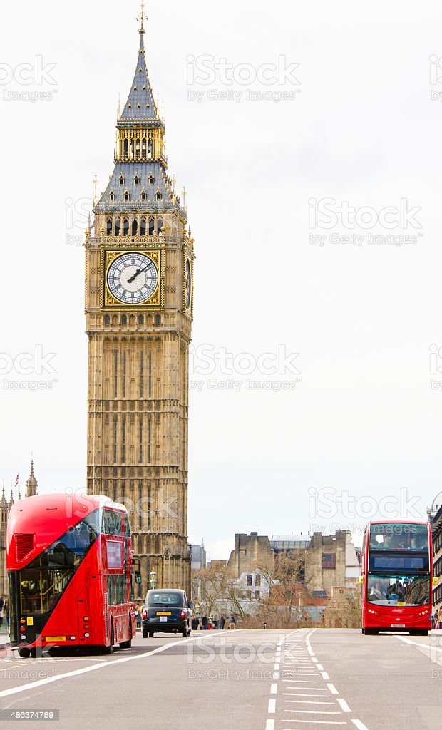 Big Ben with road, new buses and taxi royalty-free stock photo