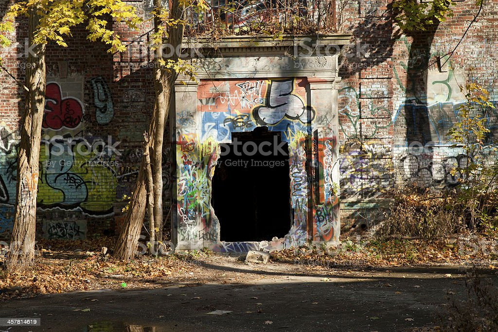 Big black hole at the abandoned building royalty-free stock photo