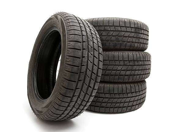 4 big black tires isolated on white