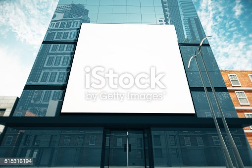 istock Big blank billboard on glassy business center at sunny day 515316194