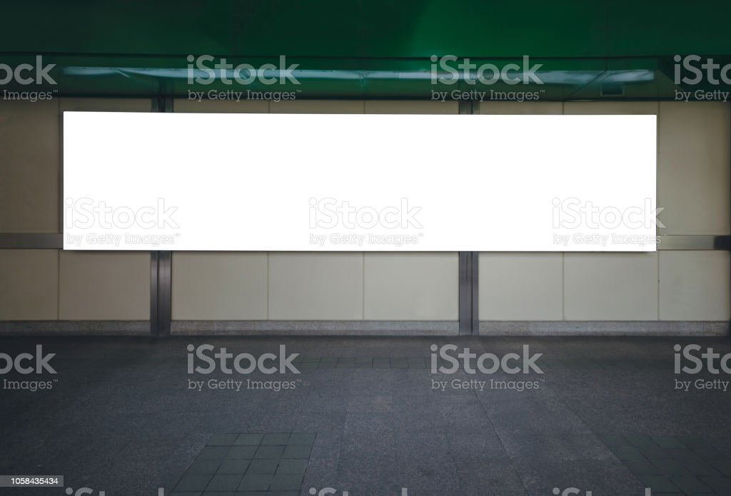 big blank billboard white LED screen horizontal outstanding in the city on pathway walking at sky train over the road traffic for display advertisement text template promotion new brand at outdoor. stock photo
