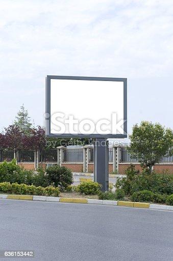 istock Big blank horizontal billboard on the city street. 636153442