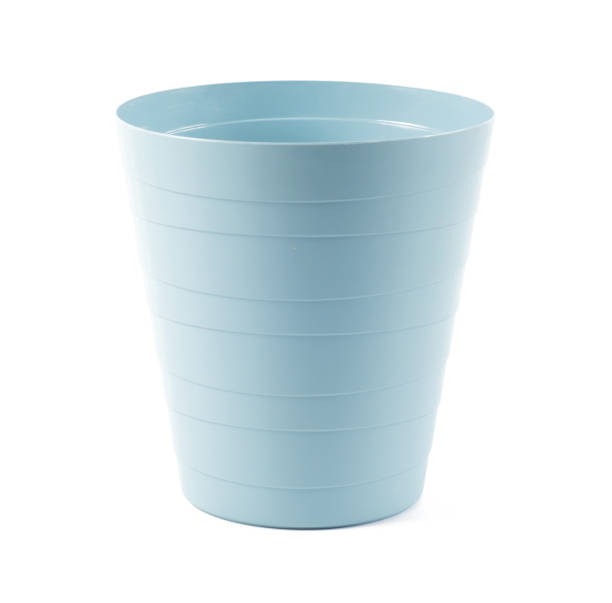 Big blue plastic basket isolated over white background stock photo