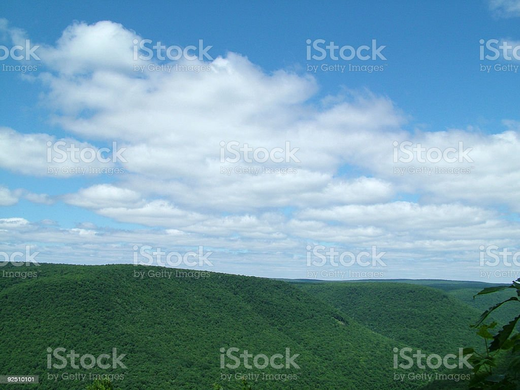 Big blue sky with clouds and mountains. royalty-free stock photo