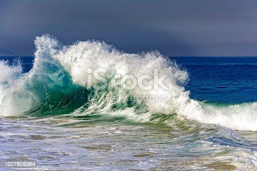 Big blue wave breaking on Ipanema beach during brazilian summer