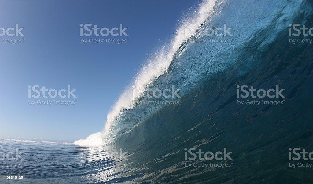 big blue wave crashes down stock photo