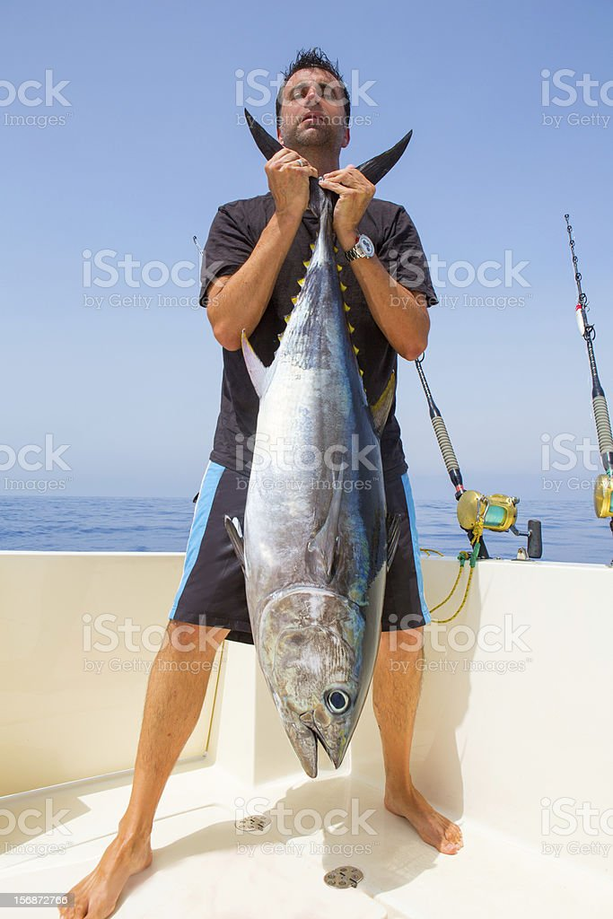 big Bluefin tuna catch by fisherman on boat trolling stock photo