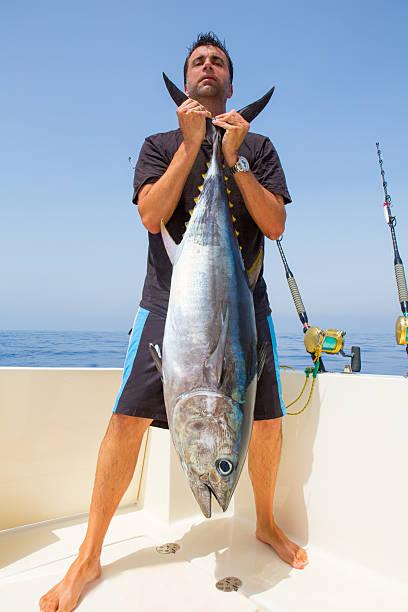 big Bluefin tuna catch by fisherman on boat trolling stock photo
