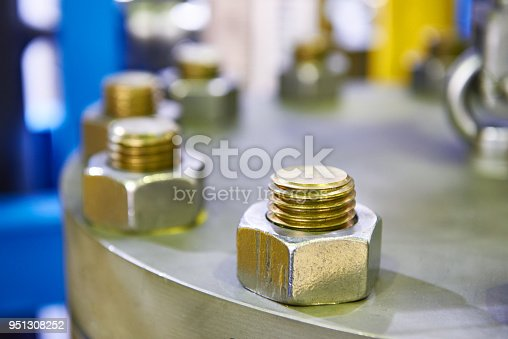 Bolt nuts on industrial equipment
