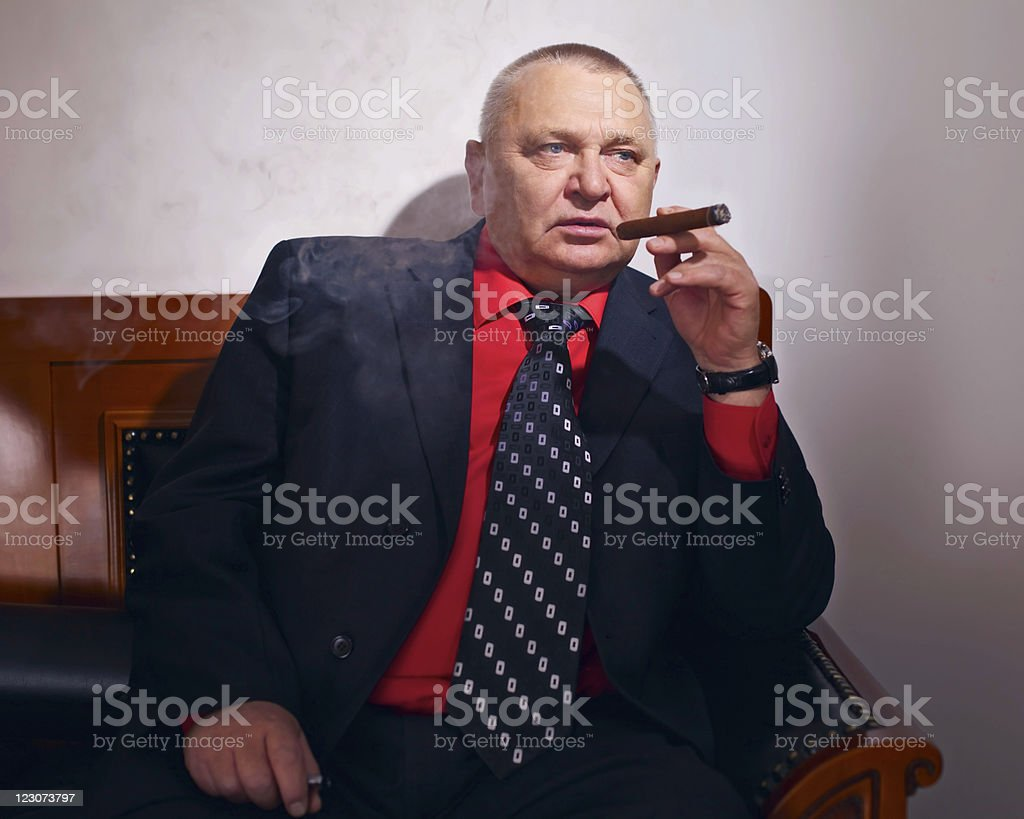Big boss smoking cigar stock photo