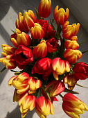 Big bouquet of red and yellow tulips. Spring tulips, big bunch, top view