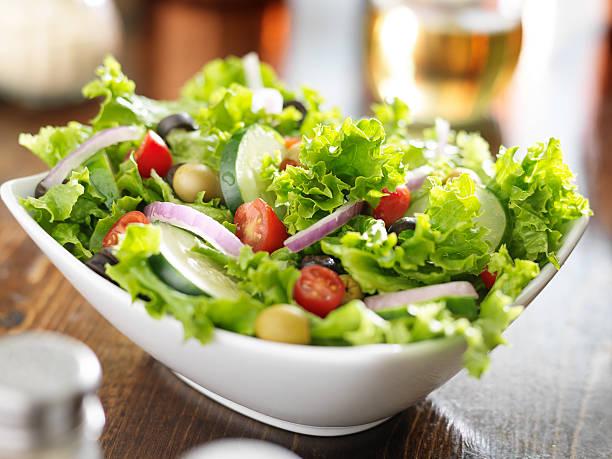 big bowl of salad stock photo
