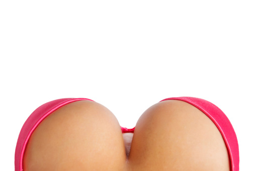 Big breasts in pink bra from above isolated on white background.