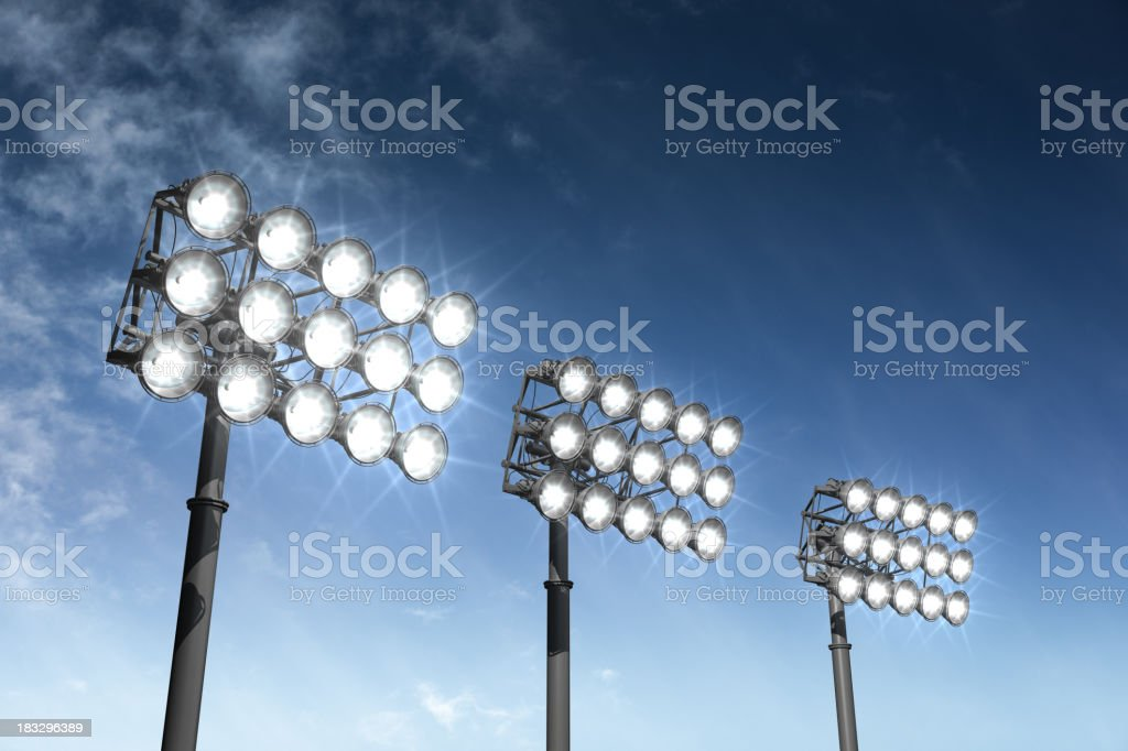 Big bright stadium lights on a summer night stock photo