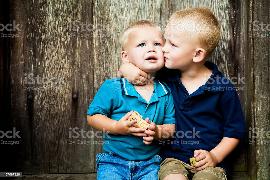 Big Brother Kissing Little One royalty-free stock photo