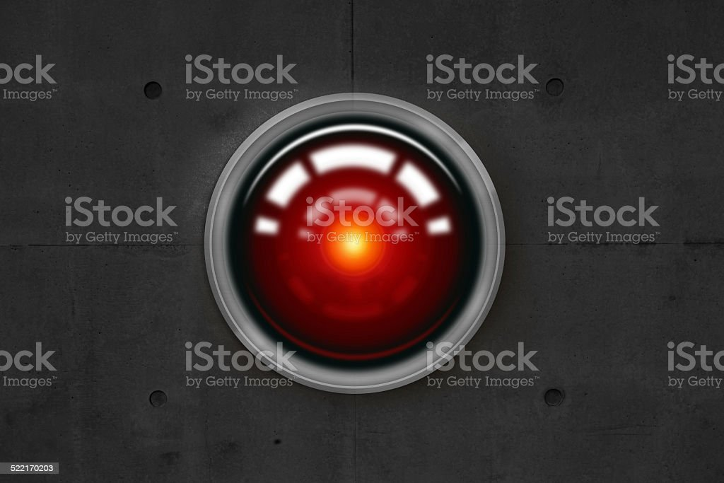 Big brother: red camera lens watching at you stock photo