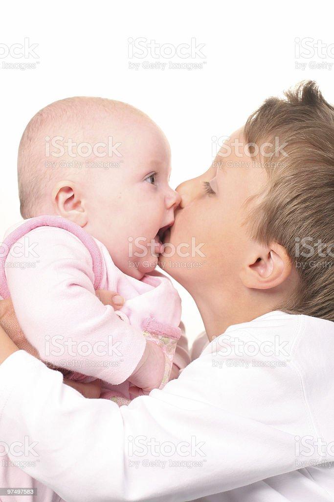Big brother's hug and kiss royalty-free stock photo