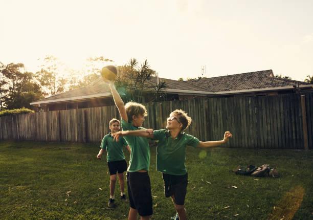 Big brothers never play fair! stock photo