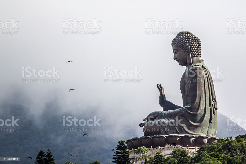 Big Buddha Tian Tan Buddha, also known as the Big Buddha. Hong Kong, China. Bird Stock Photo