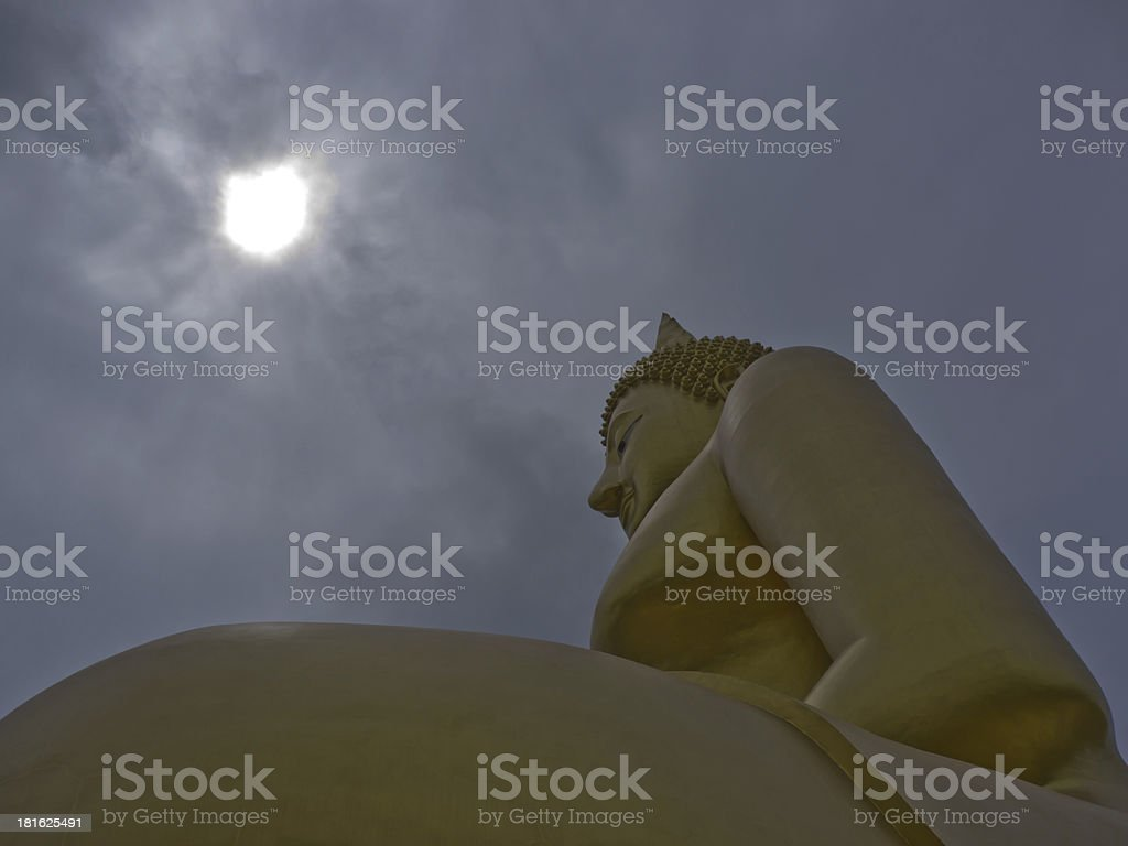 Big Buddha statue and the sun in background royalty-free stock photo