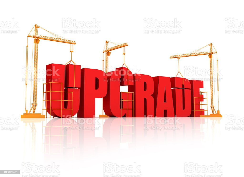 Big bulky red letters on an orange crane saying upgrade stock photo