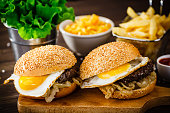 Big burgers, French fries and vegetables