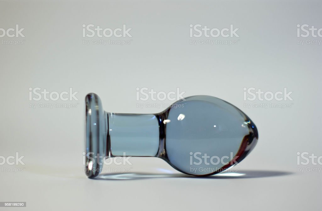 Big Butt plug transparent glass on a white background - foto stock