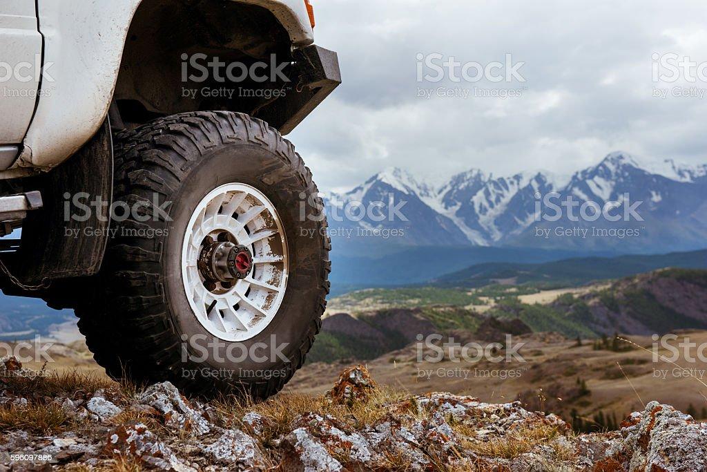 Big car wheel on background of mountains stock photo