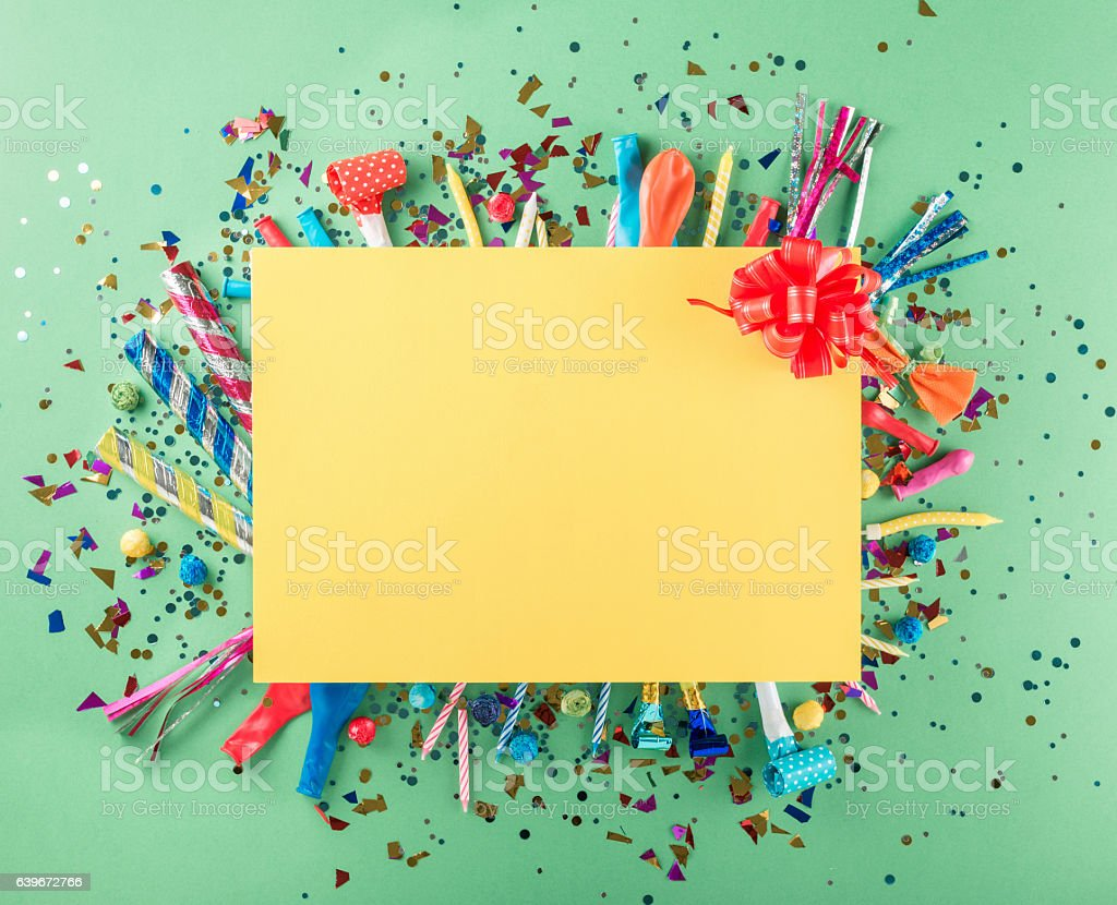 Big card with party confetti, balloons, streamers, noisemakers a stock photo