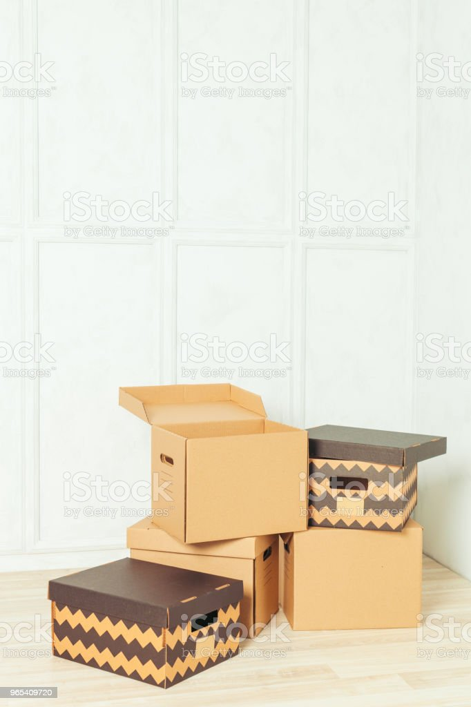 Big cardboard boxes standing insinde a room royalty-free stock photo