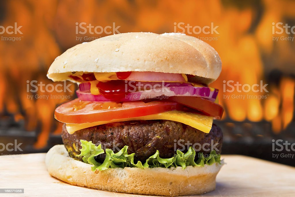 Big Cheeseburger with Pretty Flames royalty-free stock photo