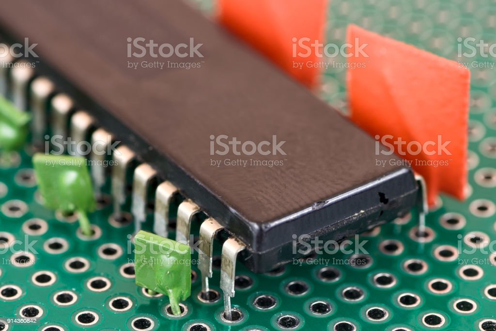 Big chip and capacitors on Printed Circuit Board stock photo