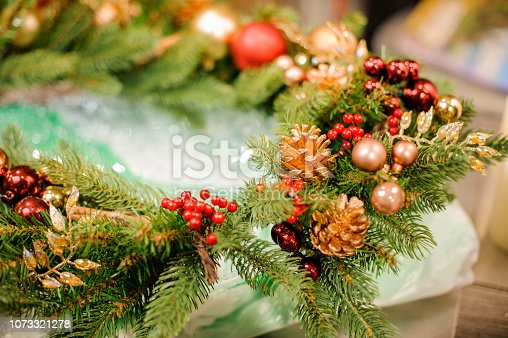 istock Big Christmas branch with golden and red decoration 1073321278