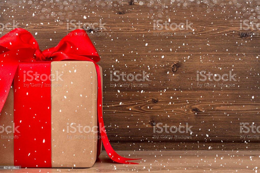 Big Christmas Gift Box on Wooden Table stock photo