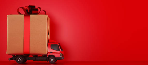 Big Christmas gift packages on a red truck ready to be delivered stock photo