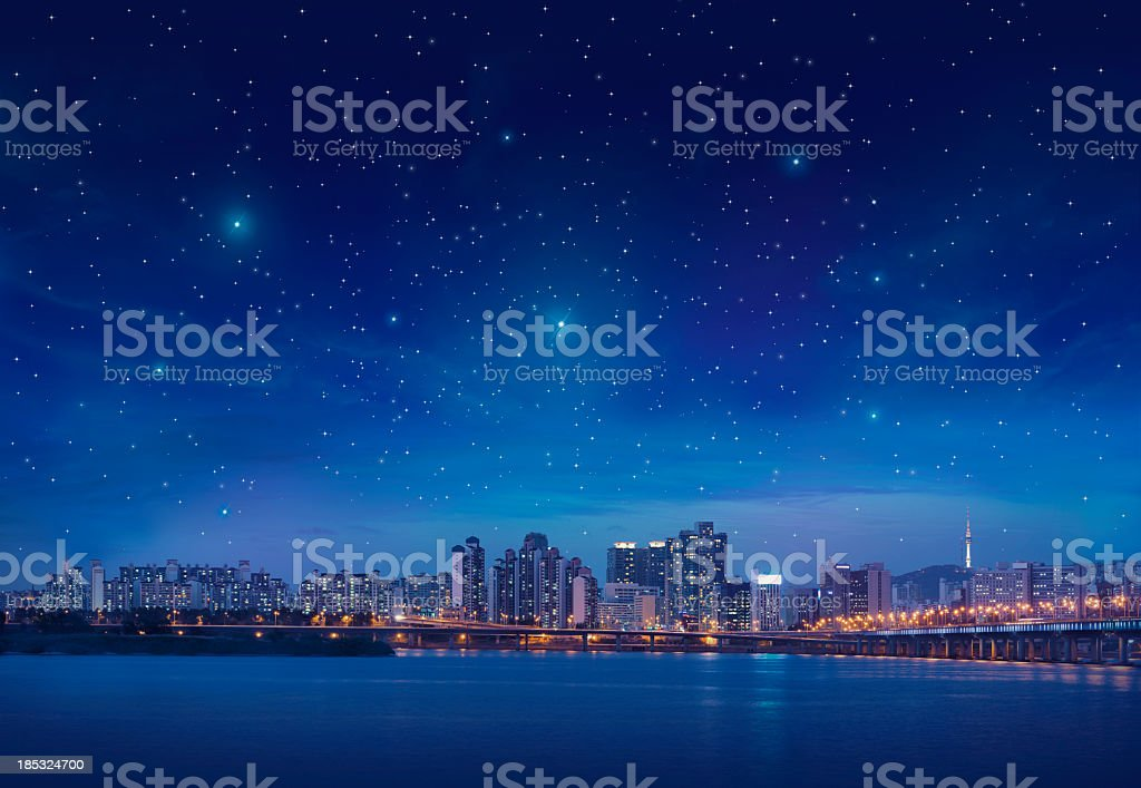 Big city by starry night stock photo