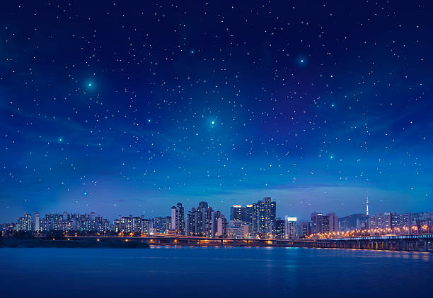 Big city by starry night stock photo