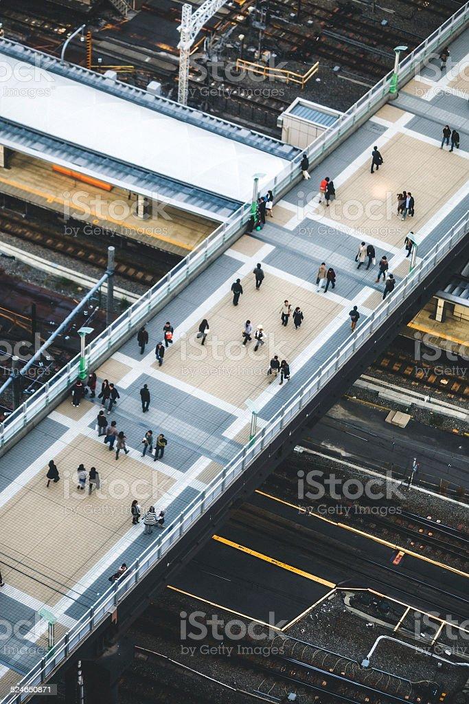Big city commuters crossing the bridge. stock photo