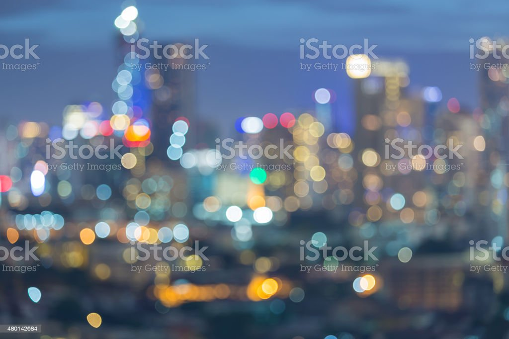 Big city light at night, abstract blur bokeh stock photo
