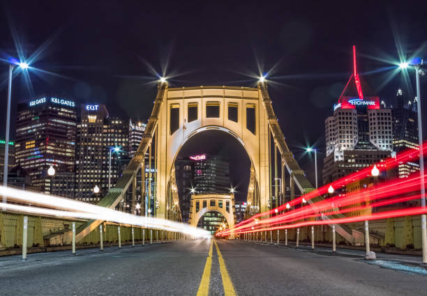 Big City Lights Light trails over a bridge in Pittsburgh, PA. pittsburgh stock pictures, royalty-free photos & images