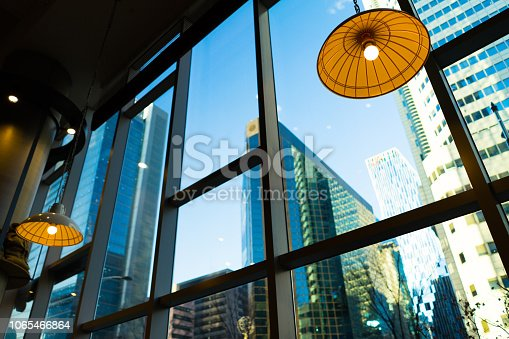 big city view from the bright morning in coffee shop.