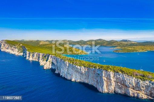 istock Big cliffs above the sea on the shore of nature park Telascica, island of Dugi Otok, Croatia 1195072651