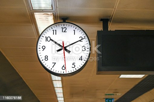 Big clock on metro station's ceiling, selective focus.