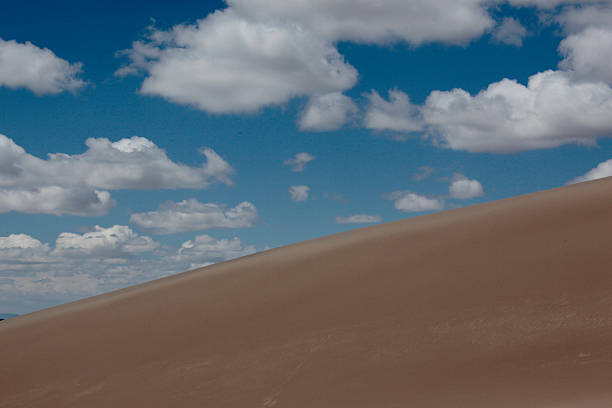 Big Clouds Over Sand Dunes stock photo