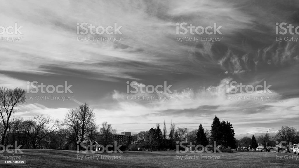 sky with big sweeping clouds with a small amount of land at the...