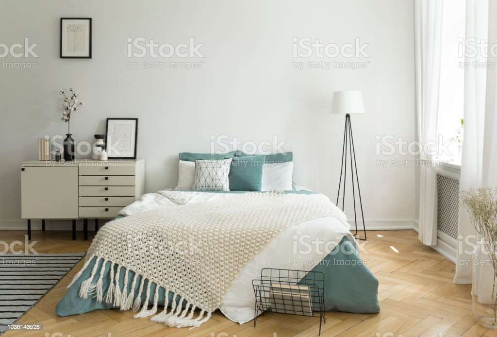 A Big Comfortable Bed With Pale Sage Green And White Linen Pillows
